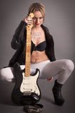 Punk girl with lots of tattoos and electric guitar Royalty Free Stock Image