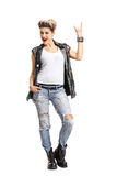 Punk girl making a rock hand gesture Royalty Free Stock Photo