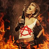 Punk girl over fire background Stock Images