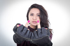 Punk girl with pink nails showing middle fingers Stock Photography