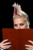 Punk girl reading book Royalty Free Stock Image