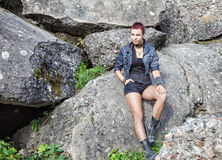 Punk Girl Sitting On A Stone Stock Photography