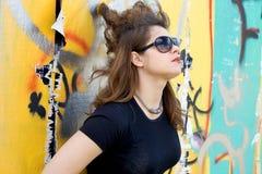 Punk girl standing near graffiti Royalty Free Stock Photos