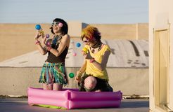 Punk Girls Juggling Plastic Balls Royalty Free Stock Photography