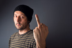Punk giving middle finger, rude gesture Stock Photography
