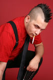 Punk guy with a cigarette Royalty Free Stock Images