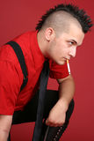 Punk guy with a cigarette Stock Photography