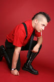 Punk guy with a cigarette Stock Images