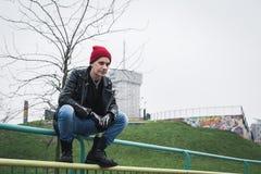 Punk guy posing in a city park Stock Photos