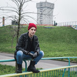 Punk guy posing in a city park Royalty Free Stock Photo