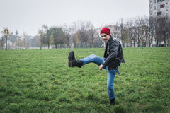 Punk guy posing in a city park Royalty Free Stock Photography