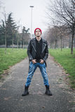 Punk guy posing in a city park Stock Photography