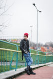 Punk guy posing in a city park Stock Images