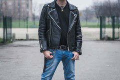 Punk guy posing in the city streets Stock Image