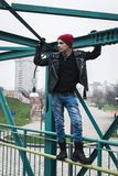 Punk guy standing on a bridge Stock Photos