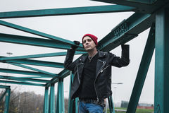 Punk guy standing on a bridge Stock Images