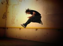 Punk Jump 2. Teenager doing a Rock Jump with intentional Grunge Feel Royalty Free Stock Images