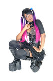 Punk lady kneeling on floor. A young steam punk African American woman in a short skirt kneeling Royalty Free Stock Photo