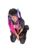Punk lady kneeling on floor. Stock Images