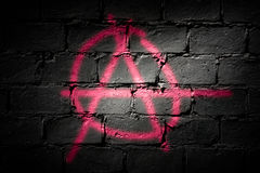 Punk letter A. Symbol for freedom and/or anarchy sprayed on dark wall Stock Images