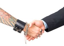 Punk man and businessman hand shake Stock Photos