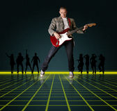 Punk man with the guitar and silhouette. Punk man with the guitar and black people silhouette Royalty Free Stock Photo