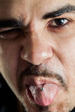 Punk man showing tongue piercing Royalty Free Stock Photo