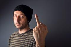 Punk que dá o dedo médio, gesto rude Fotografia de Stock