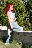 Punk red hair styled teen Stock Photo