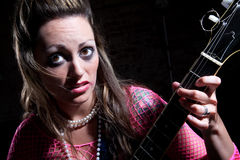 Punk Rock Girl. Young punk rocker girl with electric guitar Royalty Free Stock Photo