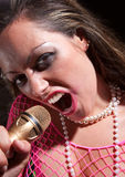 Punk Rock Girl. Brunette punk rocker girl with a microphone Royalty Free Stock Photography