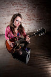 Punk Rock Girl. Punk rocker girl alone with her guitar Stock Image