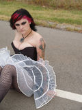 Gothic Girl Fishnet Stockings. Jet black and pink hair make this rocker chic stand out Royalty Free Stock Photos