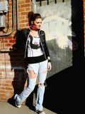 Punk Rock Girl. A punk rock girl walking behind a building royalty free stock photo