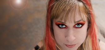 Punk rock girl. With red hair and make-up Royalty Free Stock Photography
