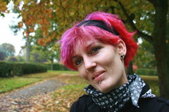 Punk Rock Girl. Young woman with coloured red hair Stock Photography