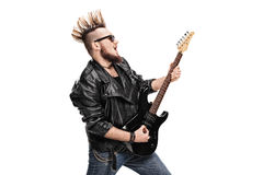 Punk rock guitarist playing electric guitar. Isolated on white background Royalty Free Stock Images