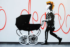 Punk rock street art. A stencilled punk rocker with stroller, spray painted on a public wall in central Oslo, Norway Royalty Free Stock Photography