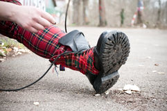 Punk rock style boot. In outdoor Royalty Free Stock Photo