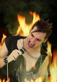 Punk Rocker. A Punk Rock singer surrounded by flames and smoke Royalty Free Stock Image