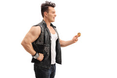Punk rocker holding a chocolate chip cookie. Profile shot of a punk rocker holding a chocolate chip cookie isolated on white background Stock Photography