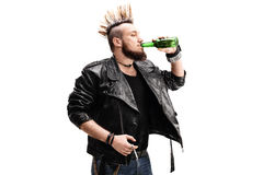 Punk rocker holding a cigarette and drinking beer Royalty Free Stock Image