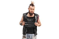 Punk rocker posing for a mug shot Stock Images