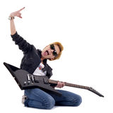 Punk Rockstar. Holding a guitar isolated in white Royalty Free Stock Images