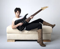 Punk Rockstar. Holding a guitar Royalty Free Stock Images