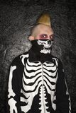 Punk with skeleton costume. Royalty Free Stock Photo