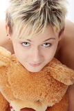Punk teen girl with teddy bear Royalty Free Stock Images