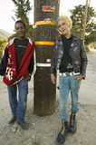 Punk teenagers,. One with blond and blue hair, the other an African American,  in Frazier Park, California Stock Photography