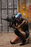 Punk woman aiming a gun Stock Images
