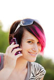 Punk woman on cell phone Stock Images